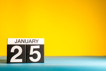 January 25th. Day 25 of january month, calendar on yellow background. Winter time. Empty space for text