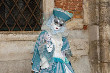 Female Venetian Mask in light blue elegant carnival costume - Venice Carnival