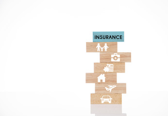 wooden blocks with insurance concept isolated on white background.