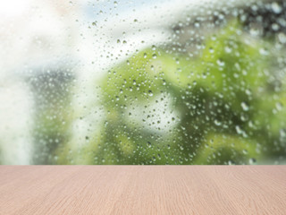 top empty wood table on blurred abstract water drop on glass background. can be used for display or montage your product.