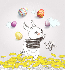 Cute hand drawn bunny dressed in striped t-shirt juggling with colorful eggs on dandelion field and Happy Easter handwritten wish against pink background with clouds. Holiday vector illustration.