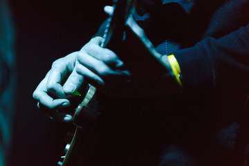Close-up of guitarist on stage