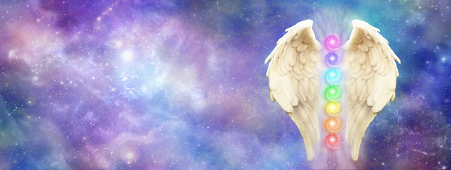 Angelic Cosmic Guardian - bright and beautiful cosmos background   with a pair of Angel Wings and seven chakras