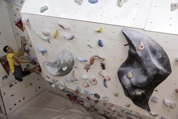 Indoor rock climbing man