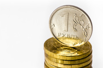 Russian ruble with pile of Russian coins
