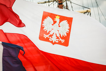 Closeup of polish national flag with emblem