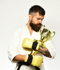 MMA sports concept. Combat master celebrates victory