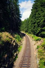 Railway in beautiful rocky forest near romantic stone bridge near Nejdek, Ore Mountains, Czech Republic