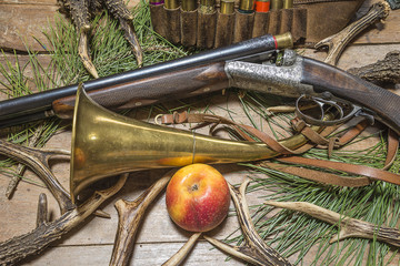 hunting rifle and equipment on old wooden background