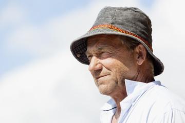 Profile view of senior man in grey fisherman hat