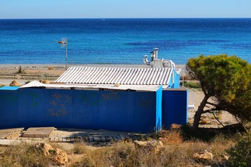 Old blue cabin on the beach in Santa Pola