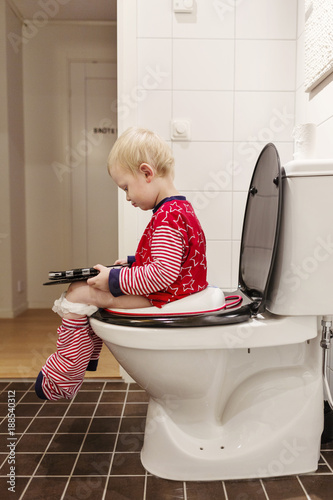 Cute Little Boy Sitting On Chair Displeased Child Stock