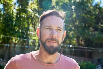 Portrait of bearded man outdoors