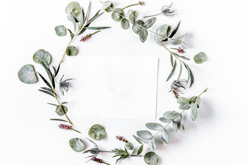 Modern spring design with plants on white background top view mo