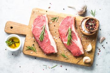 Raw beef striploin steak.Top view. Fresh meat.