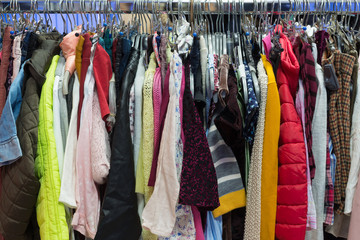 Background of different clothes hanging on the hanger