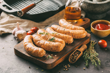 Raw sausages with herbs and spices, rustic style.