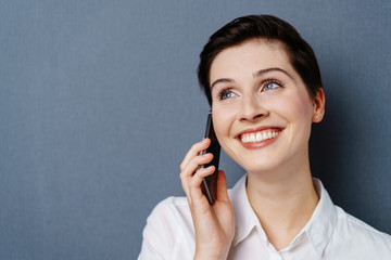 Young happy woman talking on mobile phone
