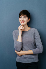 Cheerful beautiful woman thinking of a good idea