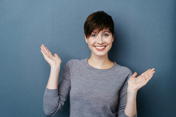 Happy confident woman gesturing with her hands