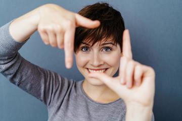 Pretty woman making a frame gesture