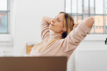 Contented successful businesswoman relaxing