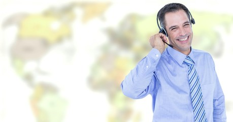 Travel agent man wearing headset in front of world map