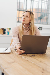 Creative woman thinking of a new idea during work
