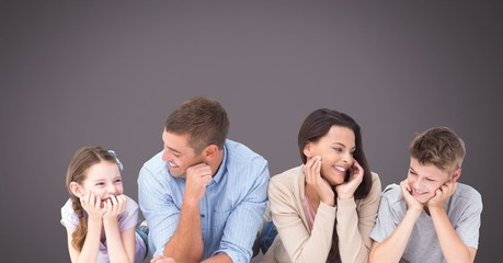 Family laughing together with grey background