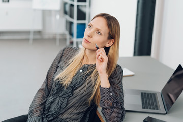 Creative woman thinking of a business project
