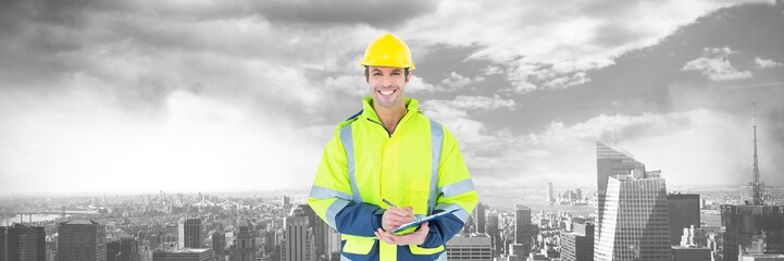 Construction Worker over large city buildings