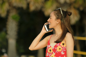 girl happy talk mobile phone in relax holiday