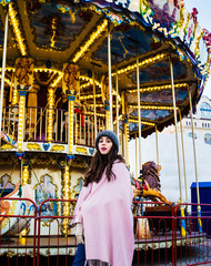 Pretty young girl wanna ride on carousel
