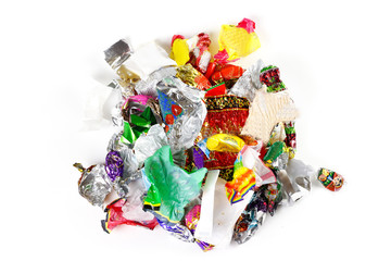 A bunch of candy wrappers on a white background. Closeup