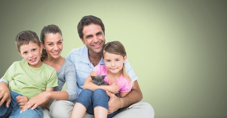 Family holding each other with green background