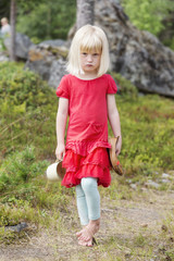 Little barefooted girl on forest path