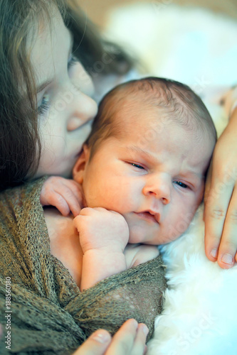 Older Sister Kisses Her Newborn Brother Sister Love Stock Photo