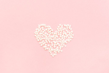 Valentine's Day composition. Heart on pale pink background. Flat lay, top view Love concept.