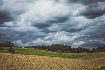 Stormy cloudscape over fields and pasture