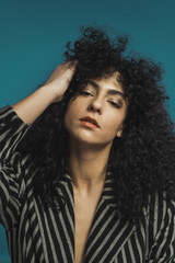 Curly woman holding hair
