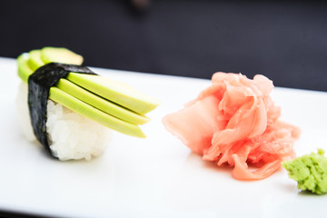 Avocado sushi served on a plate