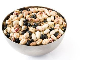 Uncooked assorted legumes in metal bowl isolated on white background.