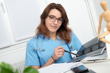 medical woman doctor looking at scan image