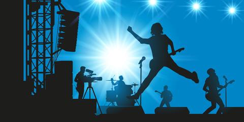concert - musique - scène - groupe de rock - guitare - chanteur - fête de la musique - caméra