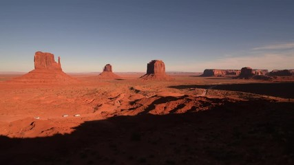 Wall Mural - Monuments Valley Tribal Park in Northern Arizona, United States of America. Desert Road with Tourists Cars.