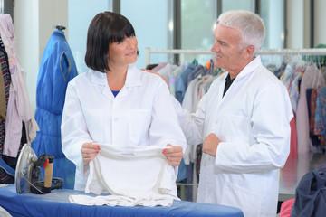 Senior couple working in laundrette