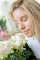 Young woman smelling some flowers
