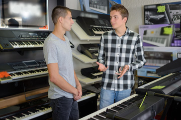Young men discussing keyboards