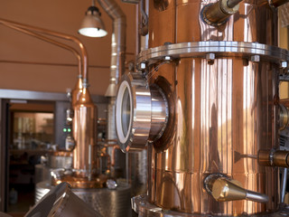 alembic still for making alcohol inside distillery, destilling spirits