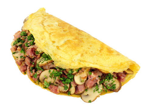 Mushroom and bacon omelette folded in half isolated on a white background